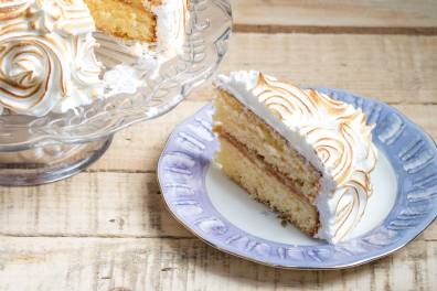 Lemon-Meringue-Cake-2-slice-on-a-plate-RoseHartSweets