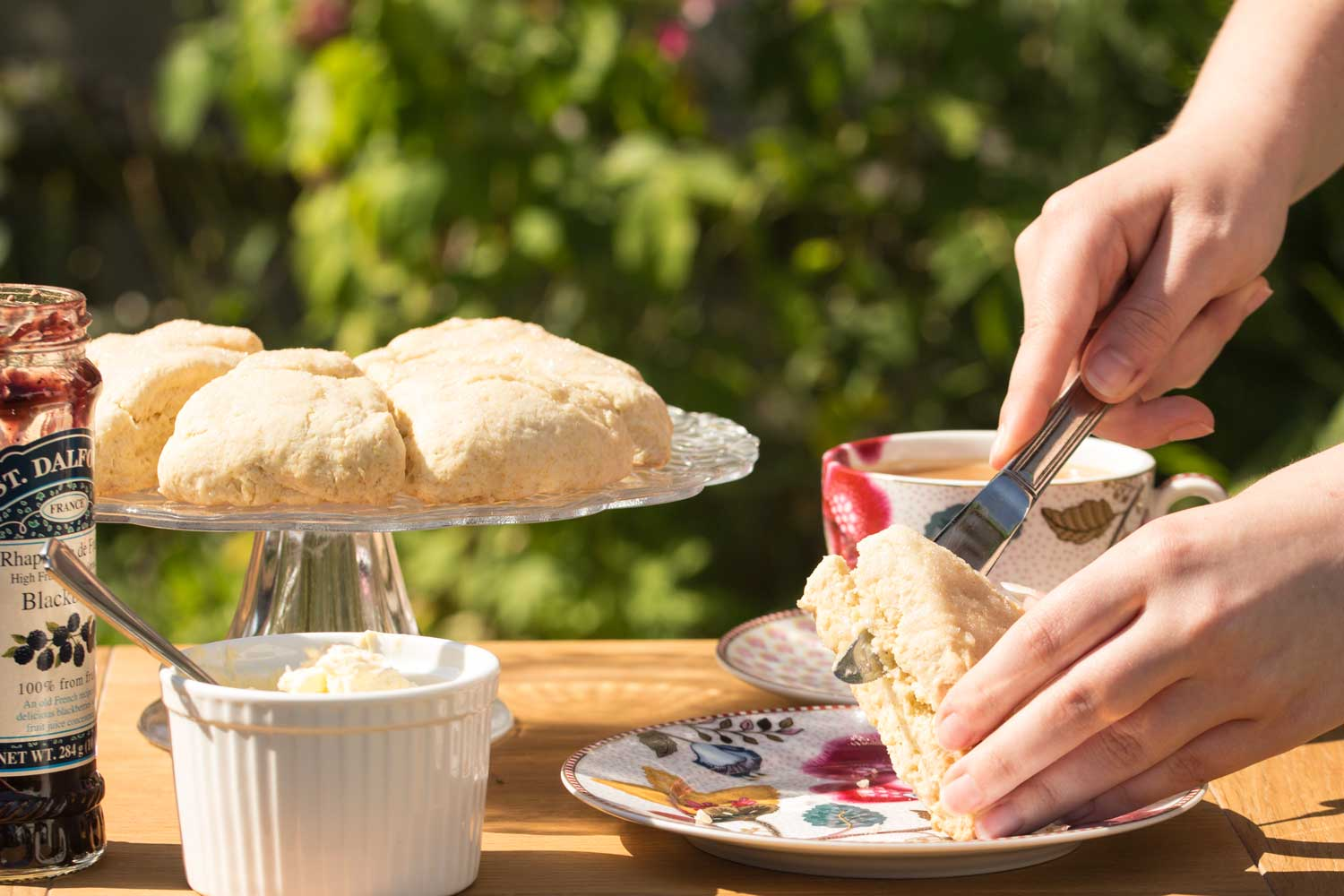 Elderflower-Drizzle-Scones-cutting-RoseHartSweets