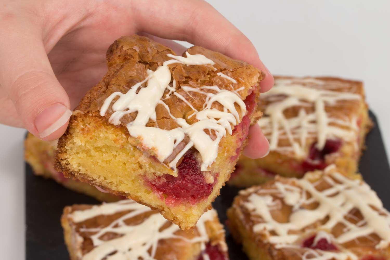 Raspberry-Blondie-slice-held-RoseHartSweets