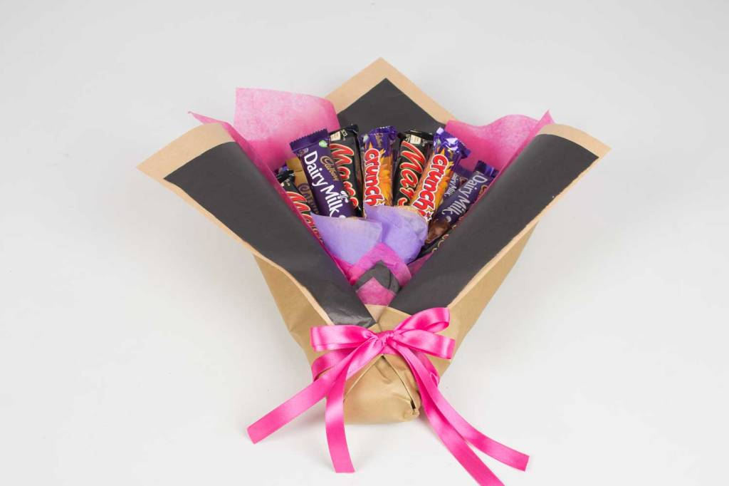 This image has an empty alt attribute; its file name is multi-chocolate-black-and-purple-rosehartsweets.jpg